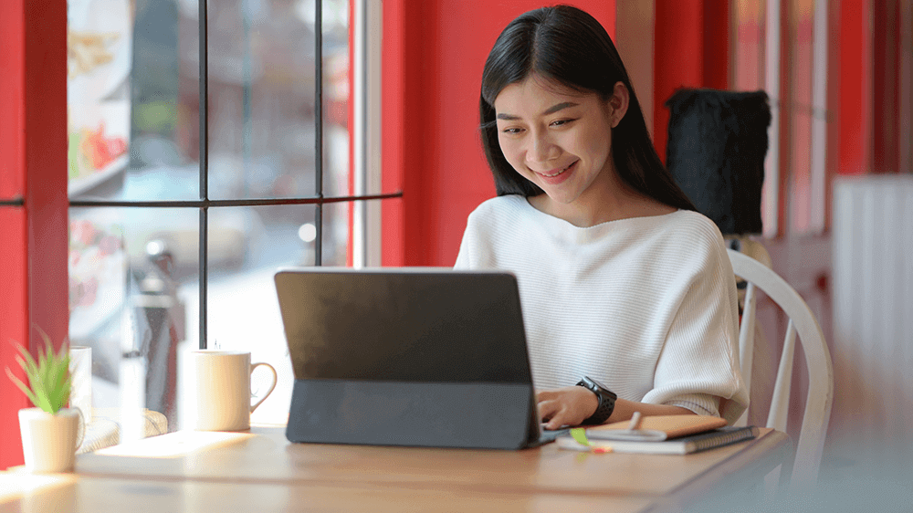 Young Asian Woman looking at computer