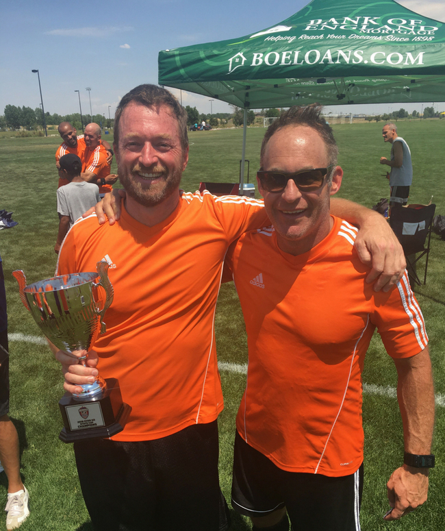 BOE Bombers: Featured: Scott Sax (left) and Mark Guenther (right), two BOE members on the Bombers Team holding Colorado State Cup